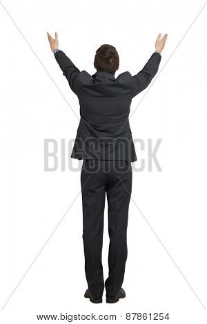 back view of man in black suit with raising hands up. isolated on white background