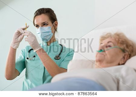 Old Lady About To Have An Injection