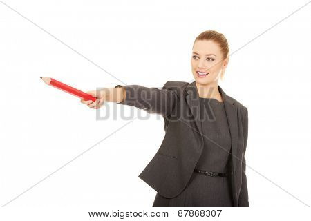 Attractive modern business woman pointing with pencil.