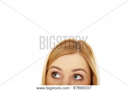 Caucasian woman's eyes looking up.