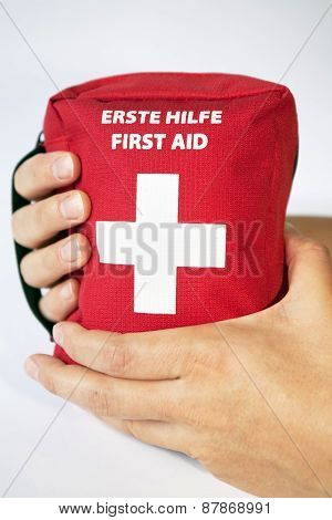 First Aid Kit With Two Hands - English And German Tittle