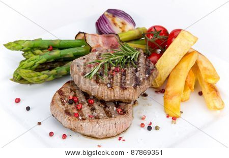 Delicious Beef steak on white background, close-up.