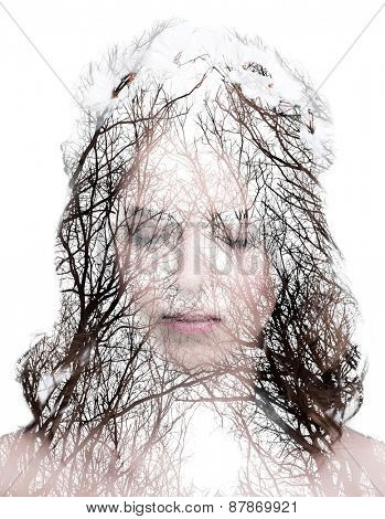 Double exposure of a young womans portrait and a forrest with no leaves over white background
