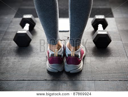 Closeup image of a female legs at gym