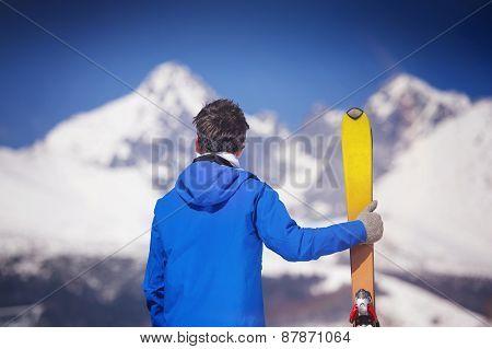 Man skiing in winter nature