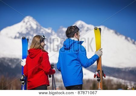 Couple skiing in winter nature