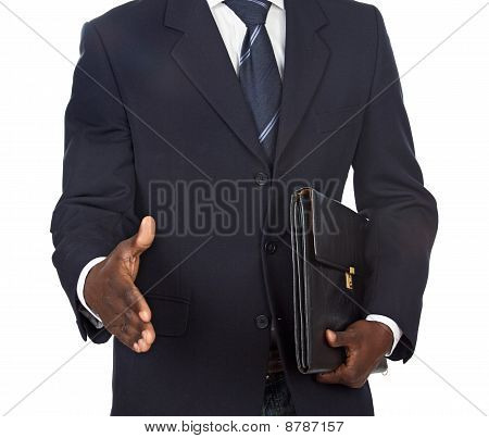 African Businessman Offering A Handshake