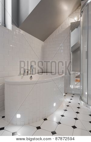 Porcelain Bathtub In White Washroom