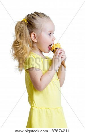 happy kid girl eating icecream in studio isolated