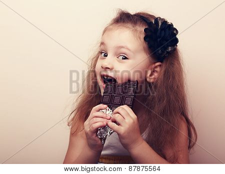 Happy Smiling Kid Girl Biting Tasty Chocolate. Vintage Portrait