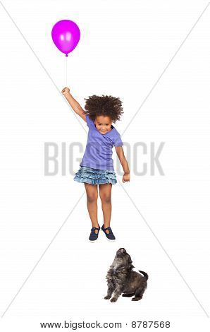 Puppy Girl Looking At A Fly With A Balloon