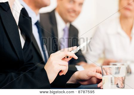 Business situation - team in meeting