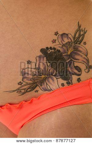 Woman In Bikini Bottom Tattoo Up Close