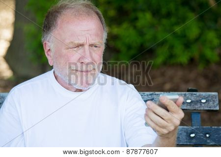Old Man Skeptical Of Text Message