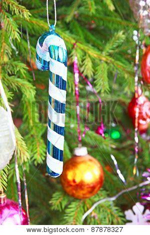 Traditional Santa Cane On Pine Branch.