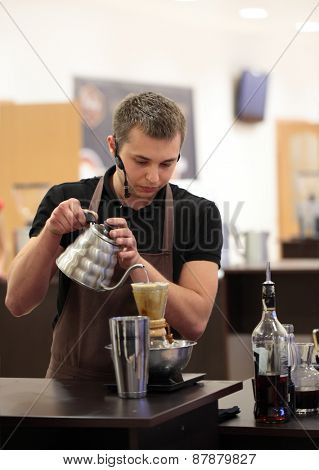 DNEPROPETROVSK, UKRAINE - JUNE 1, 2013: Barista Dmitry Shevchenko makes beverage during 5th Ukrainian Coffee In Good Spirits Championship in Dnepropetrovsk, Ukraine on June 1, 2013