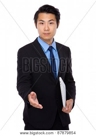 Asian business man shake hand with laptop