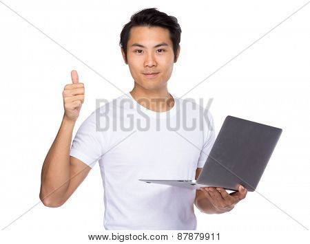 Student use of laptop and thumb up