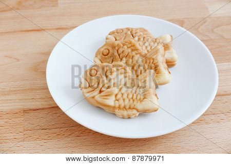 Taiyaki of japanese traditional baked sweets on wooden table