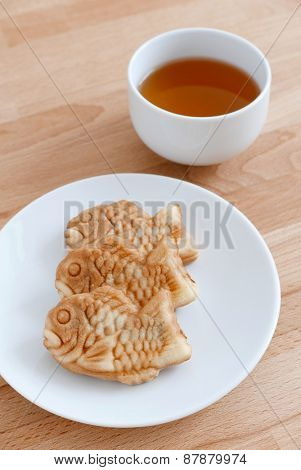 Japanese fish-shaped cake with a cup of tea