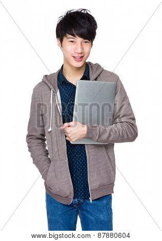 Young asian man holding laptop computer