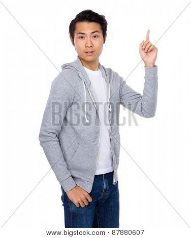 Smiling man giving number one gesture