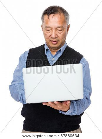 Old man learn to use laptop computer