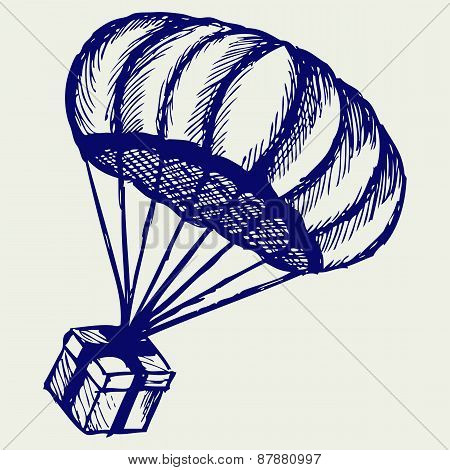 Present and parachute falling from the sky