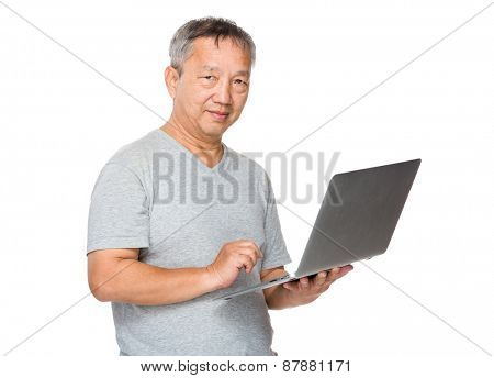 Old man learn to use of notebook computer
