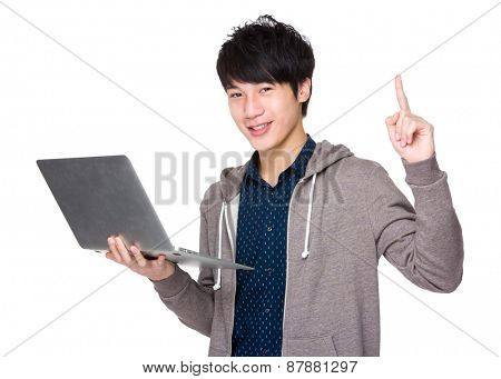 Asian handsome man use of laptop computer and finger up