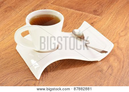 Black Tea In A White Cup And Spoon