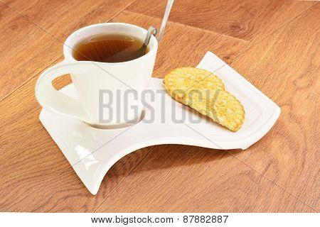 Black Tea In A White Mug And Cookies