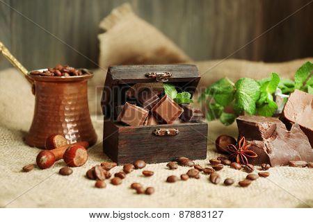 Still life with set of chocolate on burlap cloth, closeup