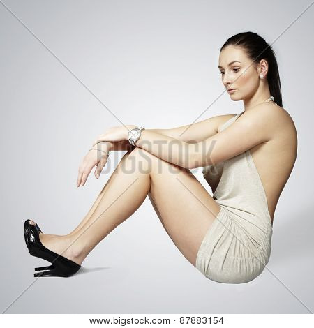 Nice lady sitting on the floor