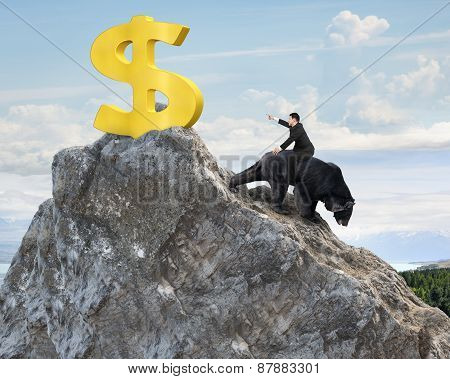 Businessman Riding Bear Pursuing Gold Dollar Sign On Mountain Peak