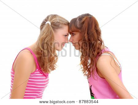 Two Teenage Sisters Staring At Each Other