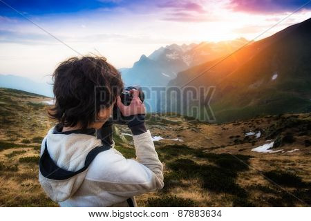 Girl Photographing The Sunset In The Mountains