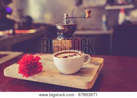 Love Message On Coffee Cup On Wooden Background With Vintage Colour Effect.