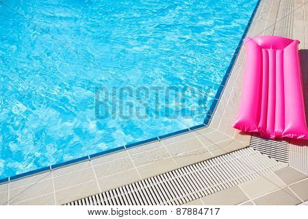 Swimming pool outdoor close up with mattress