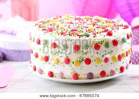 Birthday cake on colorful background