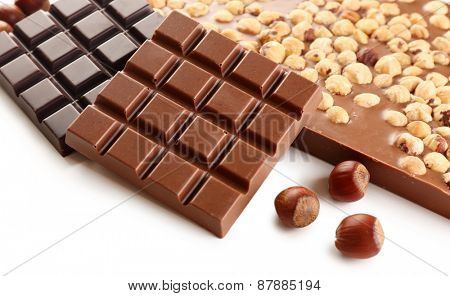 Chocolate bars with hazelnuts close up