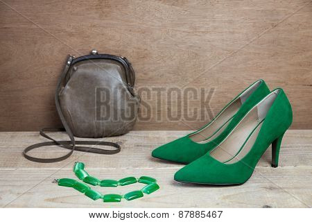 Pair of green suede shoes and handbag