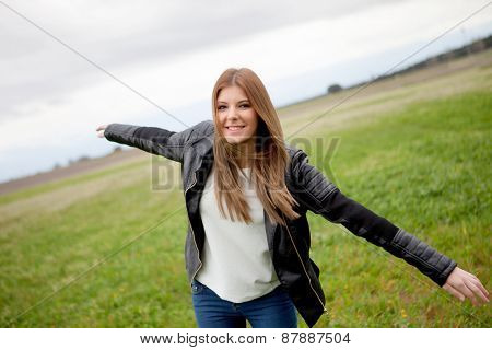Beautiful woman with leather jacket relaxing in the countryside