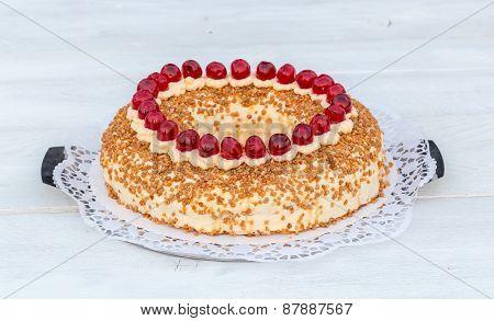 Frankfurt Crown Cake With Cherries On White Wooden