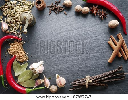 Different spices on rocked table.