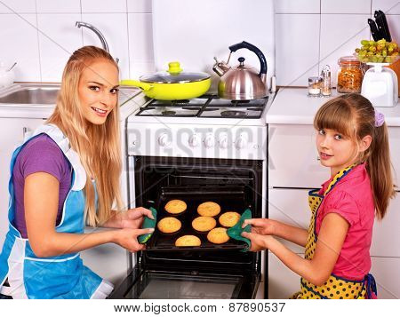 Mother and daughter bake cookies. Kitchen  at home.