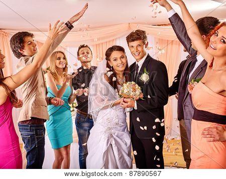 Group people in rose petal at wedding.