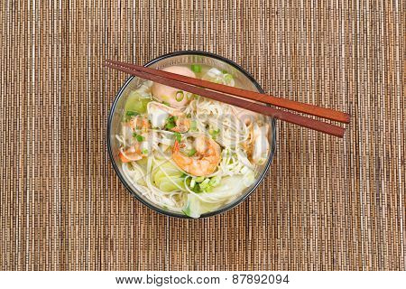 Hot Spicy Chinese Noodle Soup In Glass Bowl