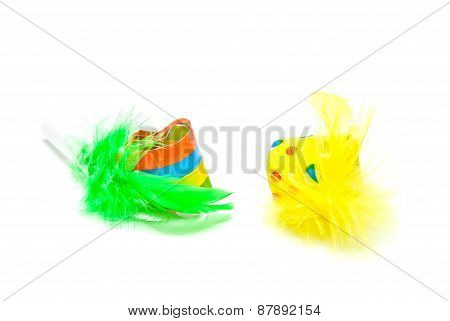 Two Festive Whistles With Feathers