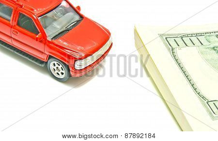 Car And Dollar Notes On White